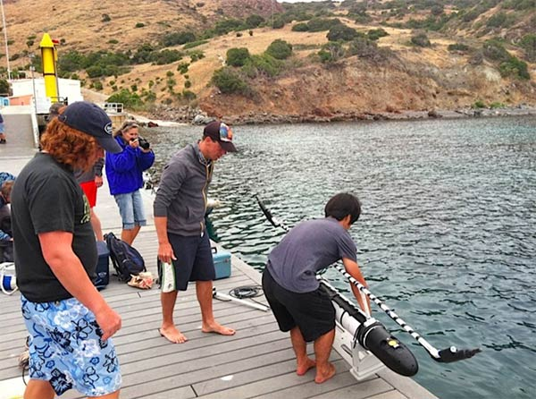 Team members from Harvey Mudd College and Cal State Long Beach get ready to set one of two robots into the water at Fisherman&#39;s Cove. <span class=meta>(KABC &#47; Lisa Bartley)</span>