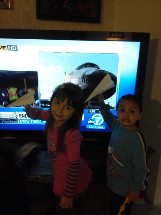 ABC7 viewer Cathy Villegas posted this photo on our Facebook page of her grandkids Yolanda and Niko watching Eyewitness News&#39; coverage of space shuttle Endeavour on Friday, Oct. 12, 2012. &#160;Send us your shuttle pictures and video to video@abc7.com or post them to the ABC7 Facebook page. You can also Tweet us @abc7 with #SpotTheShuttle. <span class=meta>(ABC7 viewer Cathy Villegas)</span>