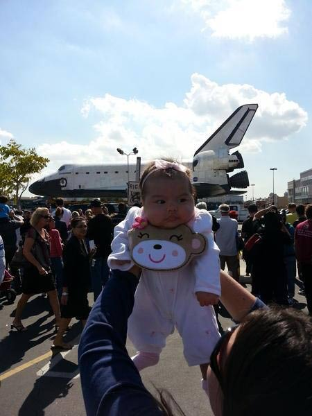 Twitter user @964brewco tweeted this photo of her baby with space shuttle Endeavour on Friday, Oct. 12, 2012. &#160;Send us your shuttle pictures and video to video@abc7.com or post them to the ABC7 Facebook page. You can also Tweet us @abc7 with #SpotTheShuttle. <span class=meta>(Twitter user @964brewco)</span>