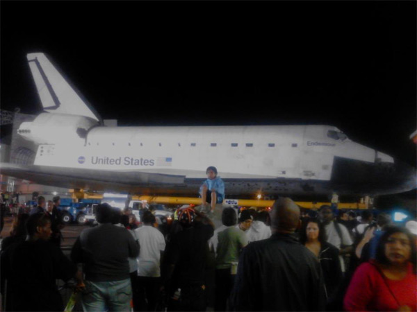 "<div class=""meta ""><span class=""caption-text "">ABC7 viewer Coco Bean posted this photo on our Facebook page of space shuttle Endeavour on Sunday, Oct. 14, 2012.  Send us your shuttle pictures and video to video@abc7.com or post them to the ABC7 Facebook page. You can also Tweet us @abc7 with #SpotTheShuttle. (ABC7 viewer Coco Bean)</span></div>"