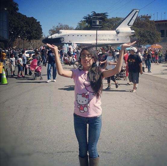 "<div class=""meta ""><span class=""caption-text "">ABC7 viewer Isabel Hernandez sent in this photo of Melissa Diaz posing with space shuttle Endeavour on Sunday, Oct. 14, 2012.  Send us your shuttle pictures and video to video@abc7.com or post them to the ABC7 Facebook page. You can also Tweet us @abc7 with #SpotTheShuttle. (ABC7 viewer Isabel Hernandez)</span></div>"