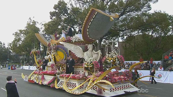 One lucky couple got married aboard the Farmers Insurance float on Orange Grove Boulevard during the 124th annual Rose Parade in Pasadena Jan. 1, 2013. <span class=meta>(KABC Photo)</span>