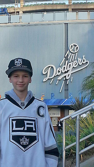 A young L.A. Kings fan stands outside of Dodger Stadium at the Stadium Series with the Anaheim Ducks on Saturday, Jan. 25, 2014. <span class=meta>(twitter.com&#47;JRReign13)</span>