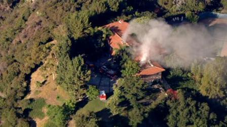 Firefighters battled a fire at a mansion in the Beverly Glen area of Los Angeles on Tuesday morning.