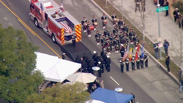 The funeral procession for fallen firefighter Glenn Allen is seen in downtown L.A. on Friday, Feb. 25, 2011.