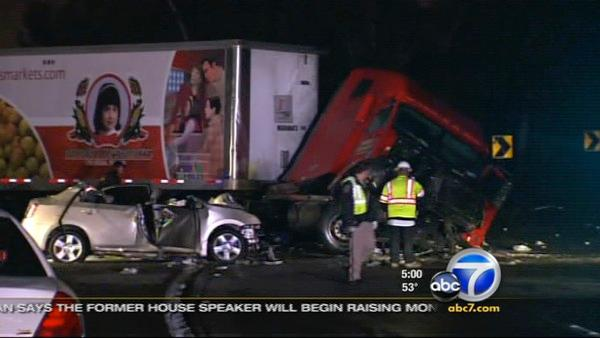 A big rig driver slammed through the center divider on the 60 Freeway just before the 605 interchange and crashed into a car, killing two women on Thursday, Mar. 3, 2011.