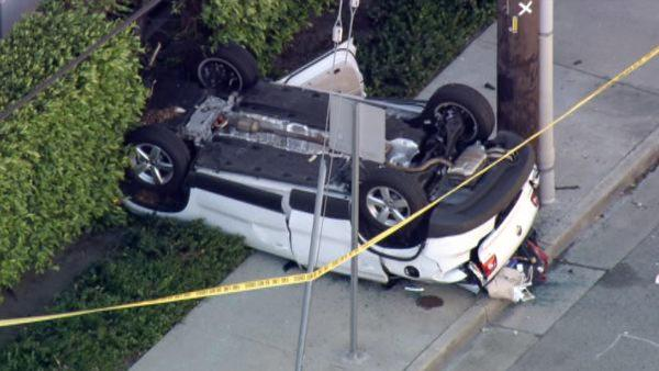 Woman dies driving off LA parking structure