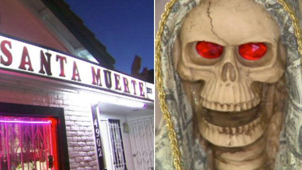 Inside the storefront of a Los Angeles temple, near the votive candles and religious posters, lays an ominous figure that's impossible to miss: a skeleton wrapped in a shroud made to look like money. S