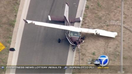 A pilot of a small plane made a safe emergency landing on Newhall Ranch Road in Santa Clarita due to engine trouble on Wednesday, June 8, 2011.