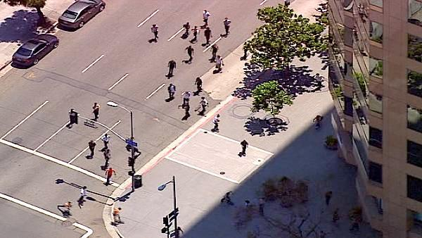 Skateboarders round a corner in downtown Los Angeles during the 'Wild in the Streets' event in celebratio