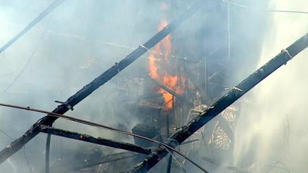 Authorities say a large 2-alarm fire broke out at a commercial building in Rosewood on Wednesday afternoon.