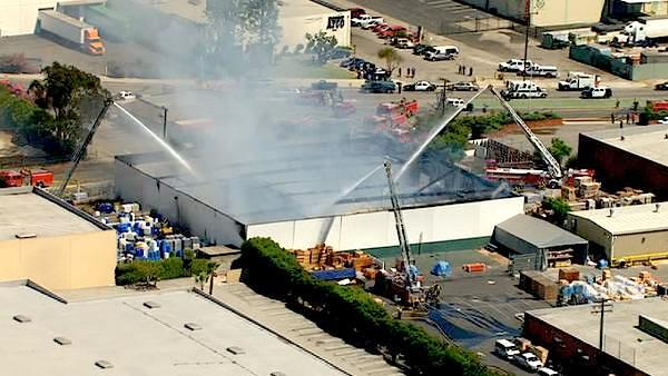 Firefighters battled a large 2-alarm commercial fire that erupted in Rosewood, near Gardena, on Wednesday, August 03, 2011.