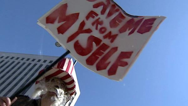 A demonstrator dressed up as Uncle Sam stands outside Los Angeles City Hall during the 'Occu