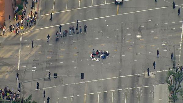 Protesters formed a circle in the middle of the intersection at Westwood and Wilshire Boulevards on Wedne