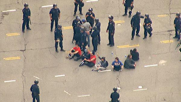 Protesters were arrested after sitting in a circle in the middle of the intersection at Westwood and Wilshire boulevards on Wednesday, Nov. 9, 2011, shutting down the busy roadway.