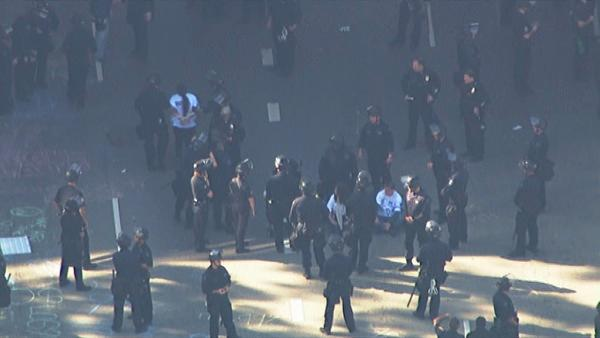 LAPD officers in riot gear move in to clear out Occupy Los Angeles protesters at 4th and Figueroa streets in downtown Los Angeles on Thursday, Nov. 17, 2011.