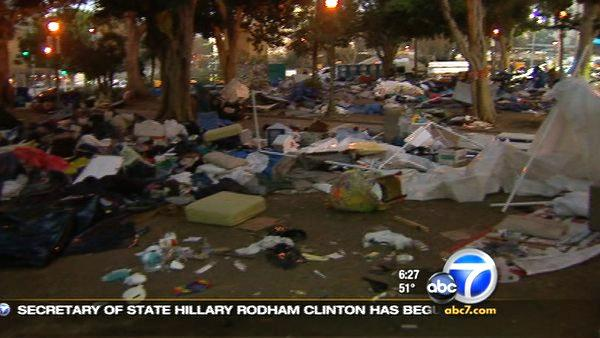 Hazmat crews started cleaning up the Occupy Los Angeles encampment on Wednesday, Nov. 30, 2011.