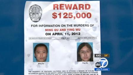 A flyer announcing the $125,000 reward for the gunman who fatally shot two USC grad students is seen in this April file photo.