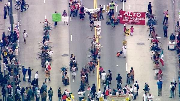 Aztec dancers perform on Broadway in downtown Los Angeles during a May Day protest on Tuesday, May 1, 2012.