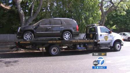 A car gets towed after decomposing remains were found inside in West Hollywood on Saturday, June 9, 2012.