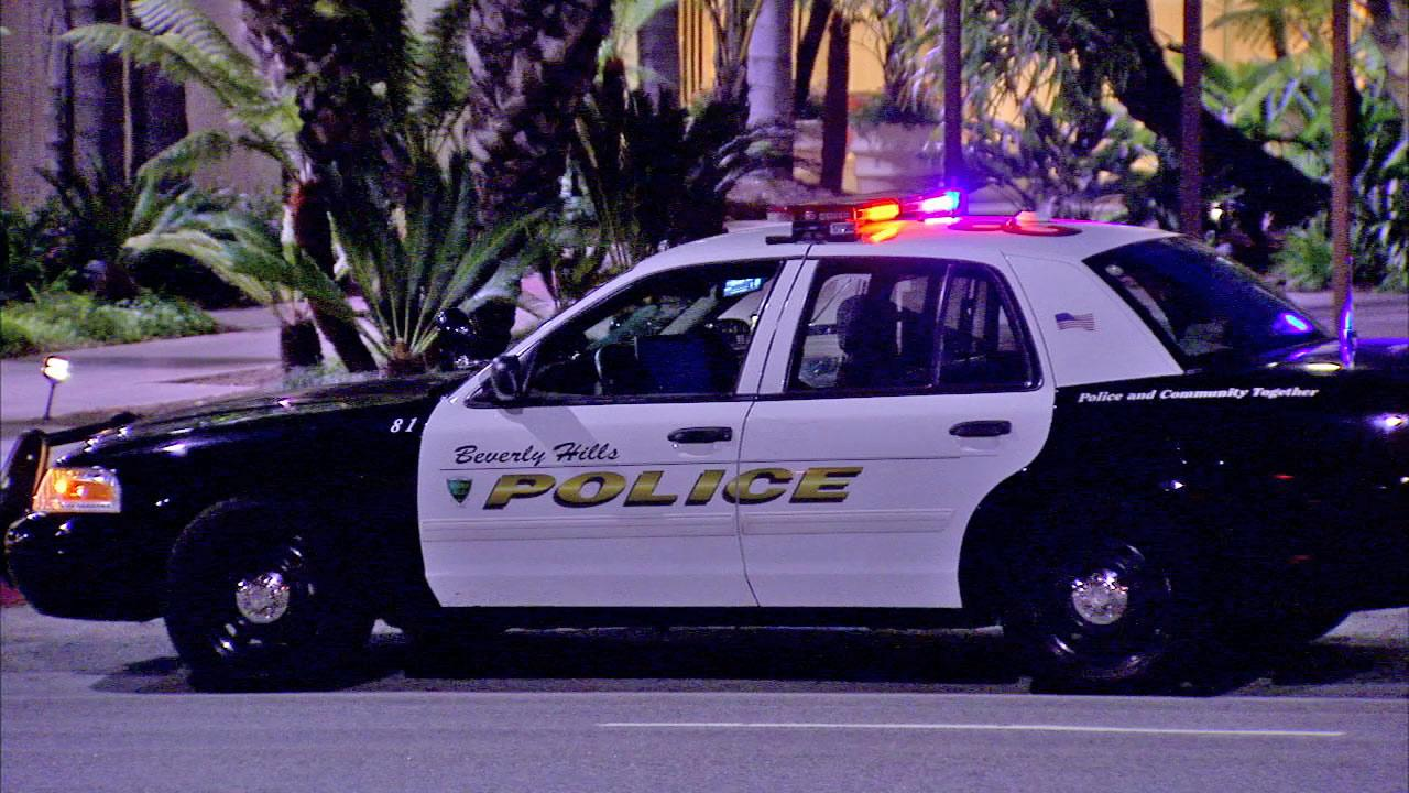 Police investigate after the bodies of an elderly man and woman were found at the Beverly Hilton on Friday, June 22, 2012.