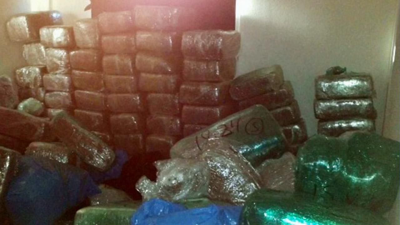 More than 2,000 pounds of large, packaged marijuana with an estimated street value of more than $6 million was discovered in a home on Cheshire Street near Elaine Avenue in Norwalk on Thursday, June 28, 2012.