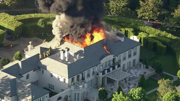 Beverly Hills mansion catches fire, injures 1
