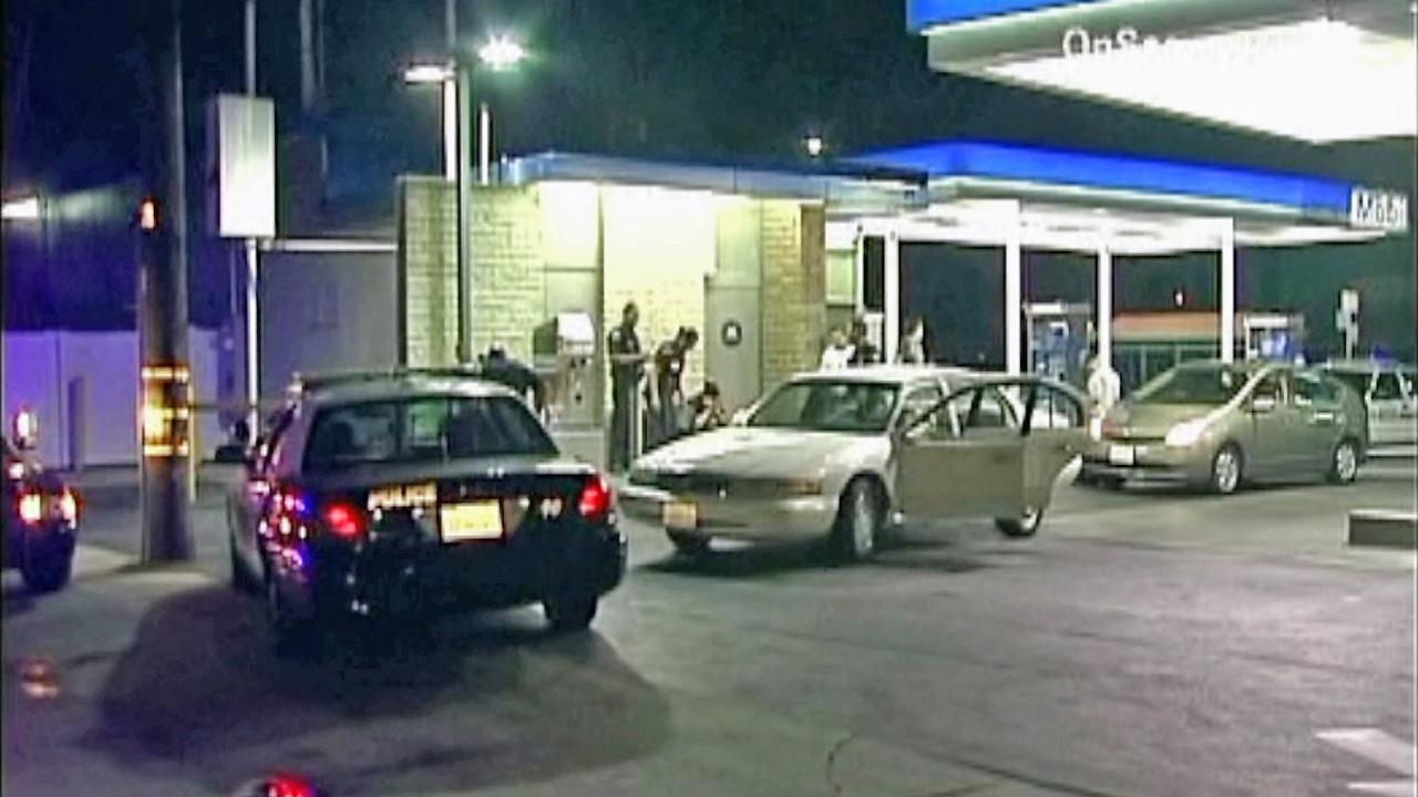 Police appear in this photo at the scene of a car-to-car shooting in Huntington Park on Monday, July 2, 2012.