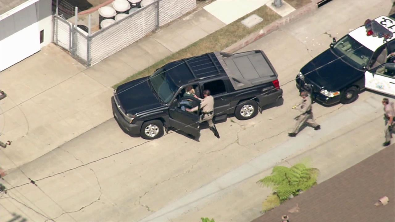 A female pursuit suspect was dragged out of her vehicle by her hair and arrested after leading California Highway Patrol officers on a wild pursuit from Orange County to West Los Angeles on Monday, July 2, 2012.
