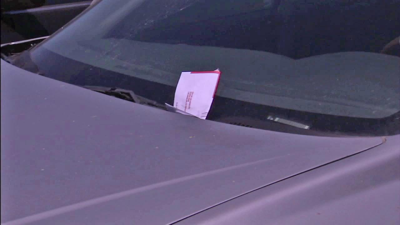 A car with a parking ticket is seen in this file photo.
