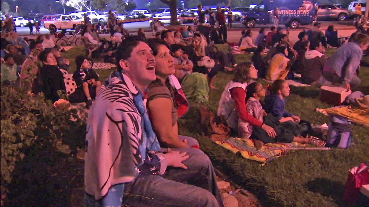 A man is seen smiling at the fireworks in the sky outside the Rose Bowl at Pasadenas annual Americafest on Wednesday, July 4, 2012.