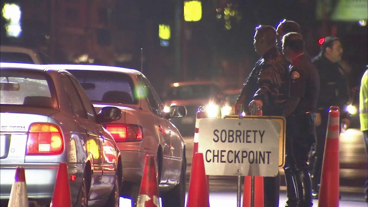Officials are seen at a DUI checkpoint in Los Angeles County.