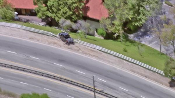 Pursuit suspect flies over embankment