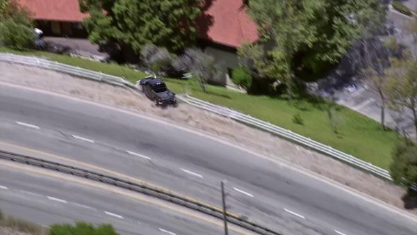 A pursuit suspect is seen driving off an embankment in Rolling Hills Estates on Tuesday, July 10, 2012.