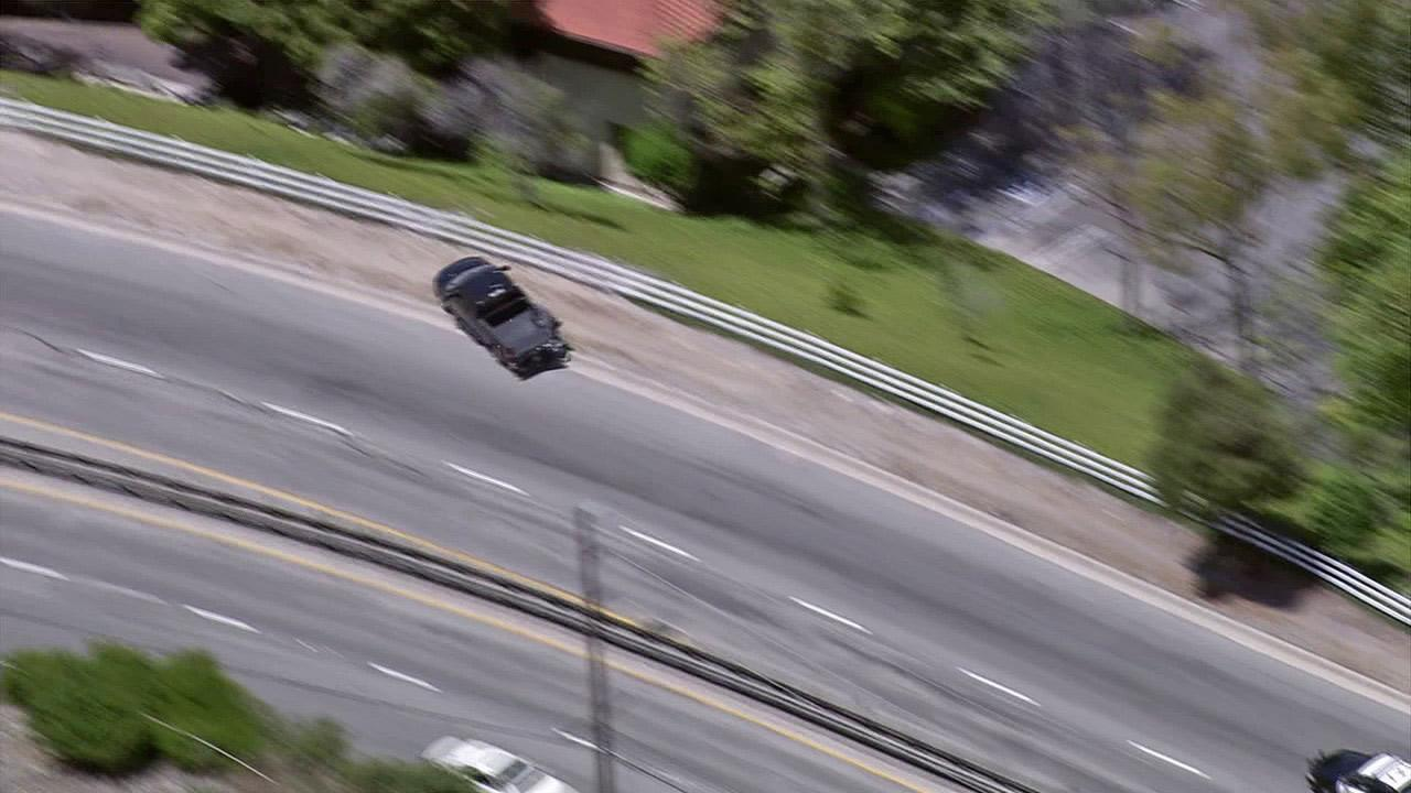 A pickup truck veers off the road in Rolling Hills Estates during a pursuit on Tuesday, July 10, 2012.