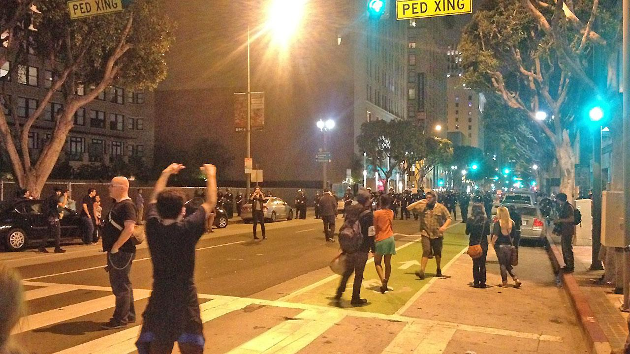 A line of LAPD officers is seen moving in on a crowd in downtown Los Angeles after a protest during the monthly Art Walk on Thursday, July 12, 2012. <span class=meta>(ABC7 viewer)</span>