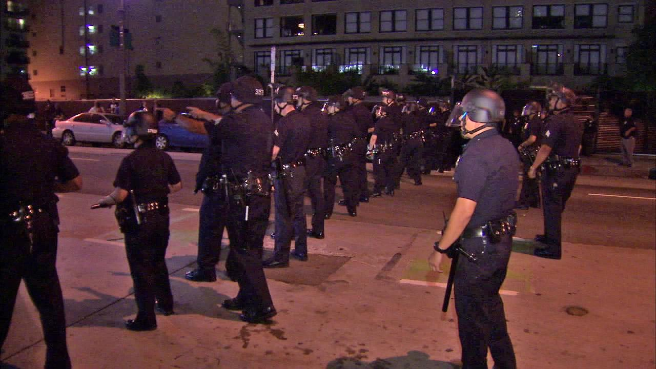 A line of LAPD officers is seen in downtown Los Angeles after a protest during the monthly Art Walk on Thursday, July 12, 2012.
