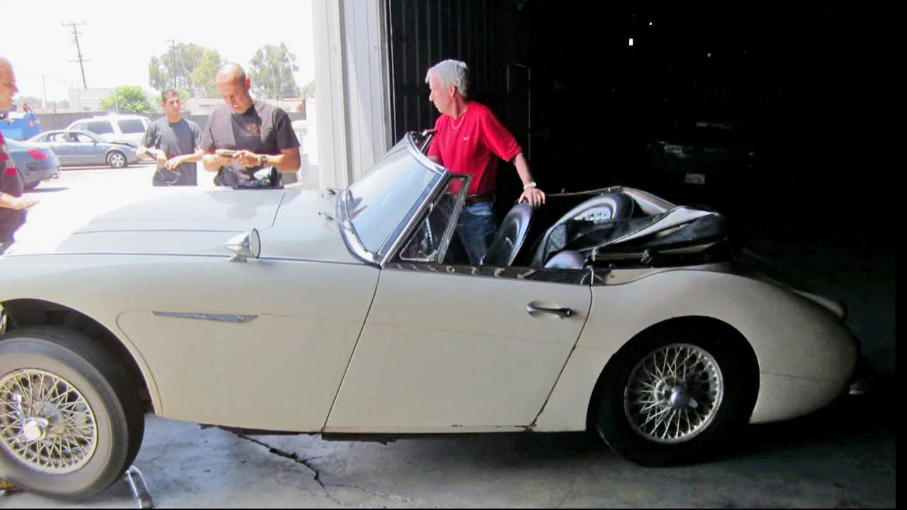 Robert Russell stands next to his 1967 Austin Healey, which he recovered 42 years after it was stolen.