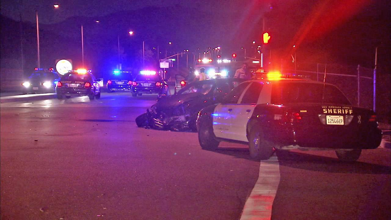 Los Angeles County sheriffs deputies investigate the scene of a crash in Diamond Bar on Sunday, July 15, 2012.