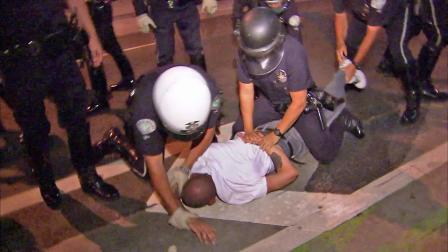LAPD officers are seen preparing to handcuff a man during a clash with Occupy LA protesters at the Downtown LA Art Walk on Thursday, July 12, 2012.