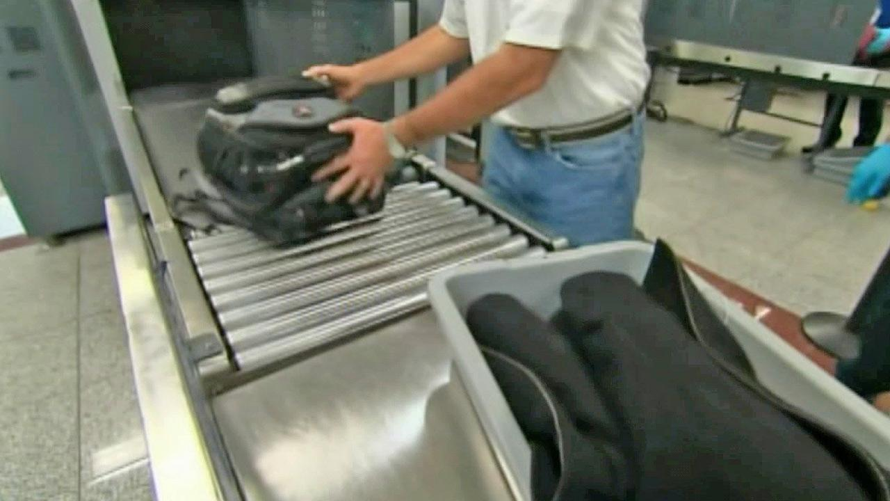 A traveler sends his baggage through the security check at the airport in this undated file photo.