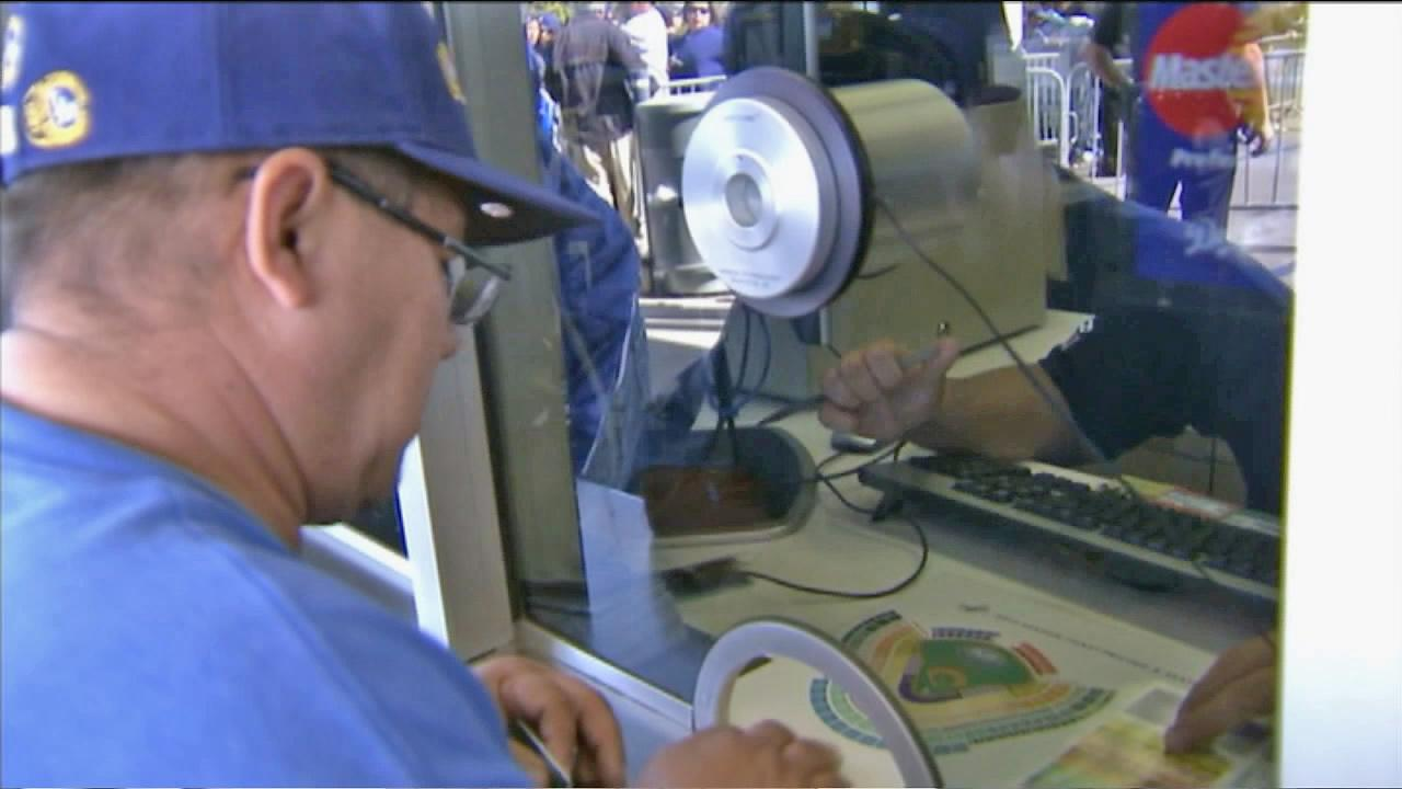 A man is seen looking at the layout of Dodger Stadium at a ticket booth in this undated file photo.