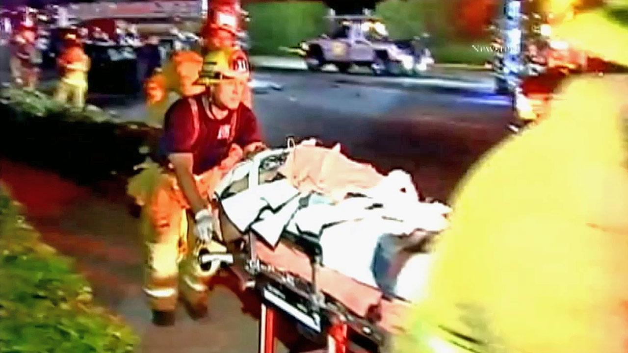 An injured person is wheeled away in a gurney following a car crash in Westlake on Sunday, Aug. 12, 2012.