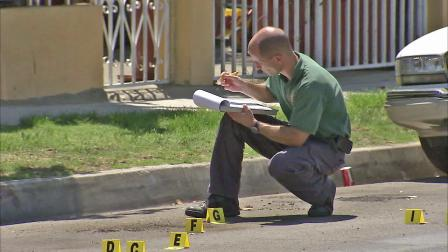 An investigator is seen at the site of a shooting in Norwalk that killed a man on Sunday, August 12, 2012.