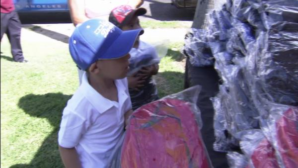 LA kids get free backpacks w/ school supplies