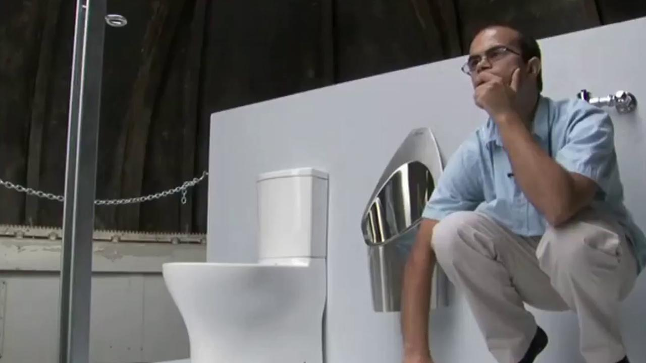 Graduate student Clement Cid with the Caltech teams solar-powered toilet.