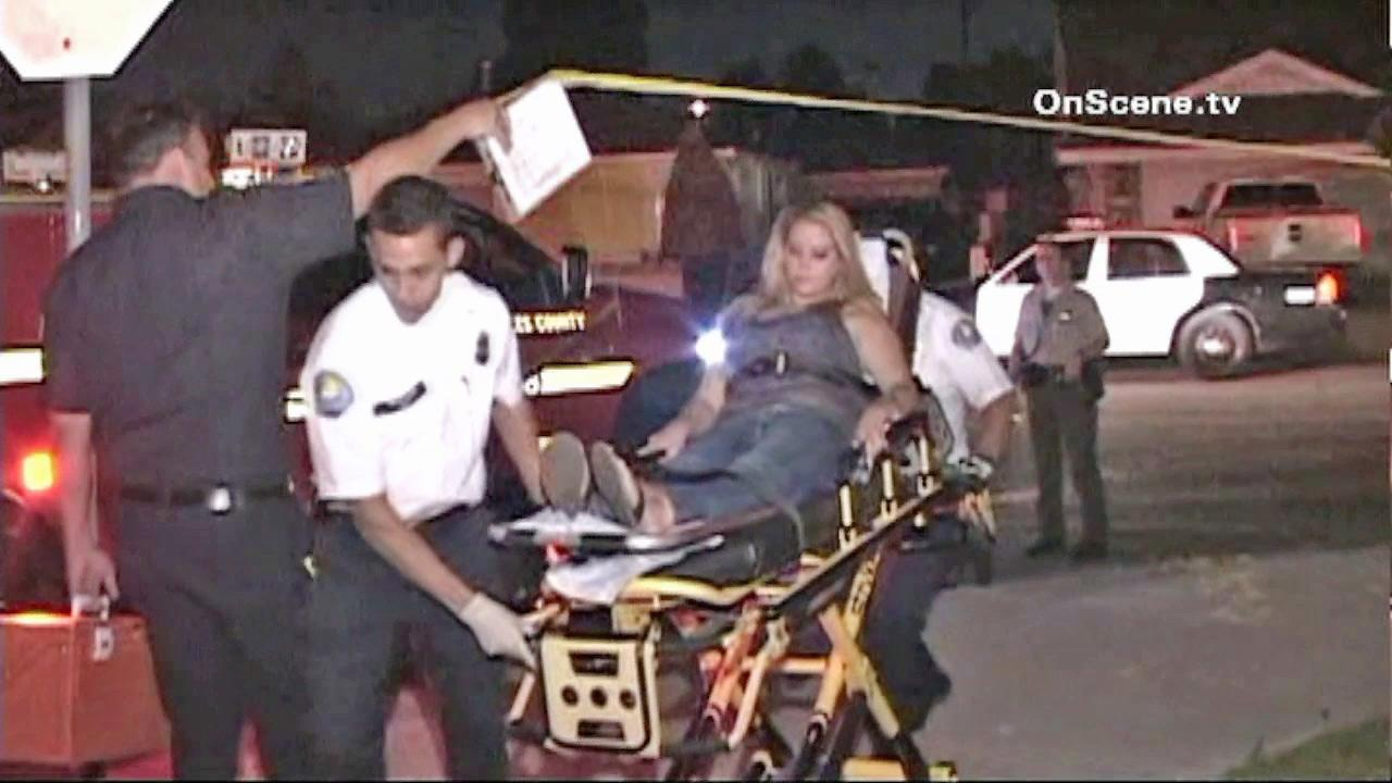 A pregnant woman is seen being taken to an ambulance in Norwalk after she allegedly stabbed her live-in boyfriend on Monday, August 28, 2012. The woman complained of discomfort after the alleged incident and was taken to the hospital.