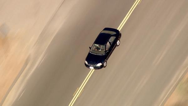 A car is seen after it exited the freeway during a pursuit near Sylmar on Friday, August 31, 2012.