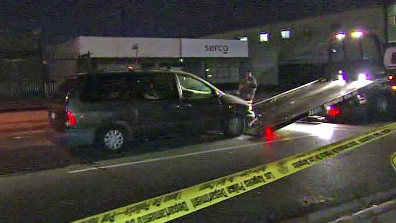 A car driven by a suspected drunken driver gets towed behind police tape in Glassell Park on Friday, Sept. 7, 2012.