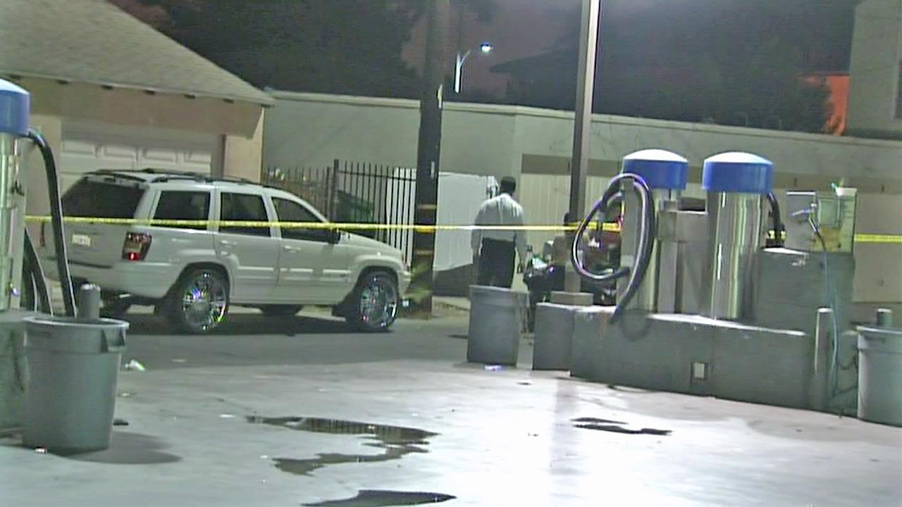 Authorities appear at the scene of a shooting in Compton that killed one person and injured two others on Monday, September 10, 2012.